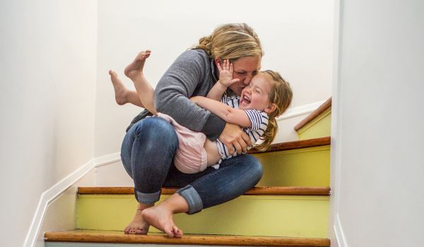 Mother hugging child on stairs