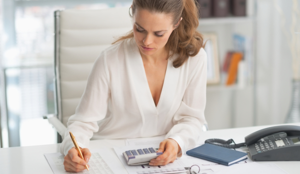 Woman calculating stamp duty